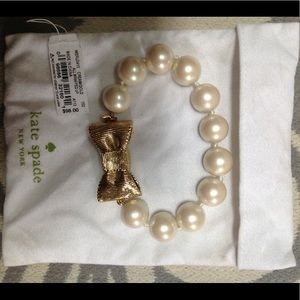 Pearl with gold bow kate Spade bracelet.